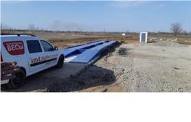 Автомобильные весы на дорожных плитах в поле (автовесы ВАЛ до 80 тонн, длинна ГПУ 18 метров)