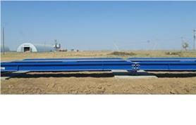 Автомобильные весы 80 тонн, 24 метра на фоне русского поля.