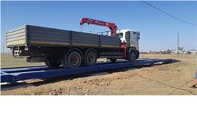 Проезд автокрана по автовесам после завершения монтажных работ. Автомобильные весы колейного типа ВАЛ-М- 80/40-24