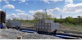 Настройка вагонных весов образцовыми гирями общим весом 60 тонн
