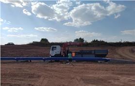Разгрузка гирь для калибровки и сдачи в поверку автомобильных весов 80 тонн, 24 метра ВАЛ